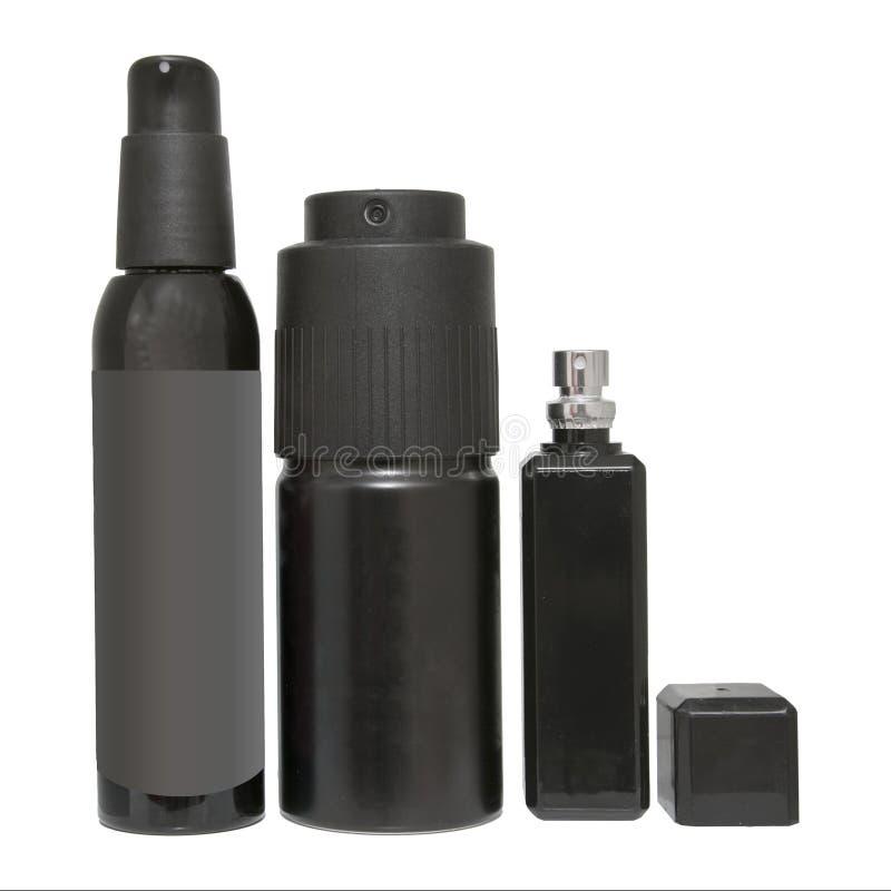 Ensemble noir de jet d'aérosol Bouteilles d'isolement de plan rapproché de désodorisant ou de parfum photo stock