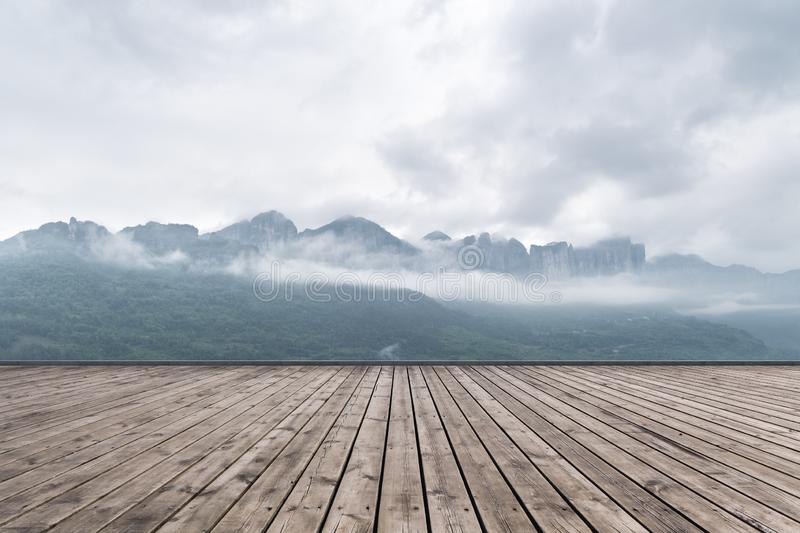 Enshi grand canyon landscape and wooden floor. Enshi grand canyon in cloud mist and wooden floor,natural landscape background royalty free stock photo