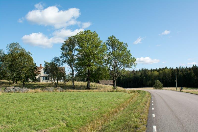 Ensilage Farm liggande i Sverige arkivfoton