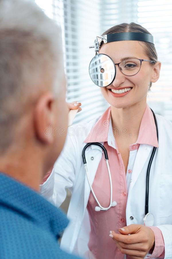 ENT doctor examining patient. And his throat royalty free stock photos