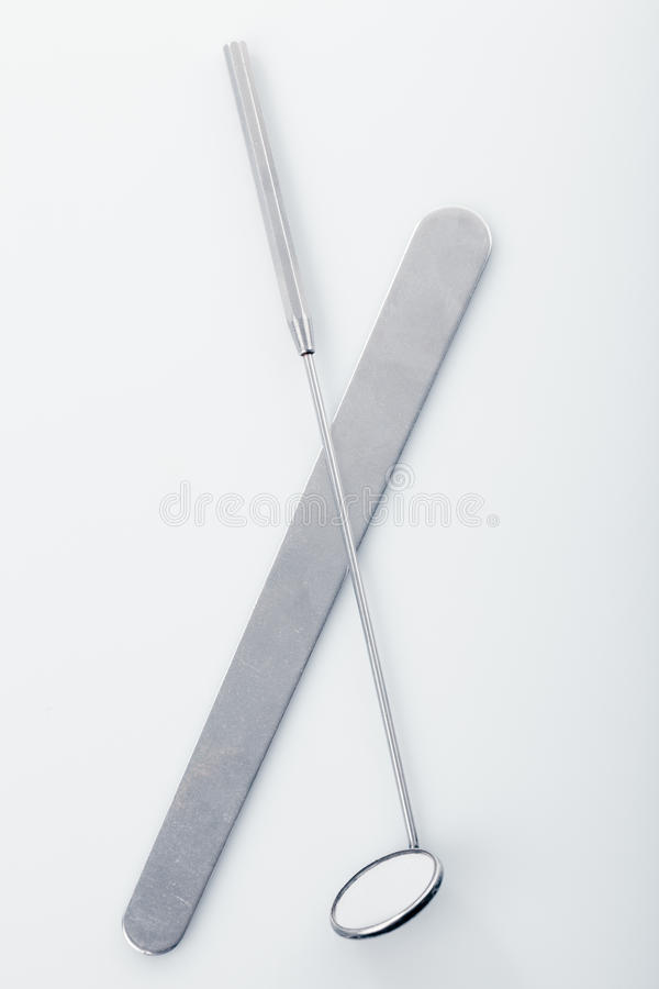 ENT tools. Medical instruments for ENT doctor: mirror and scapula for throat. Diagnostic concept royalty free stock photos