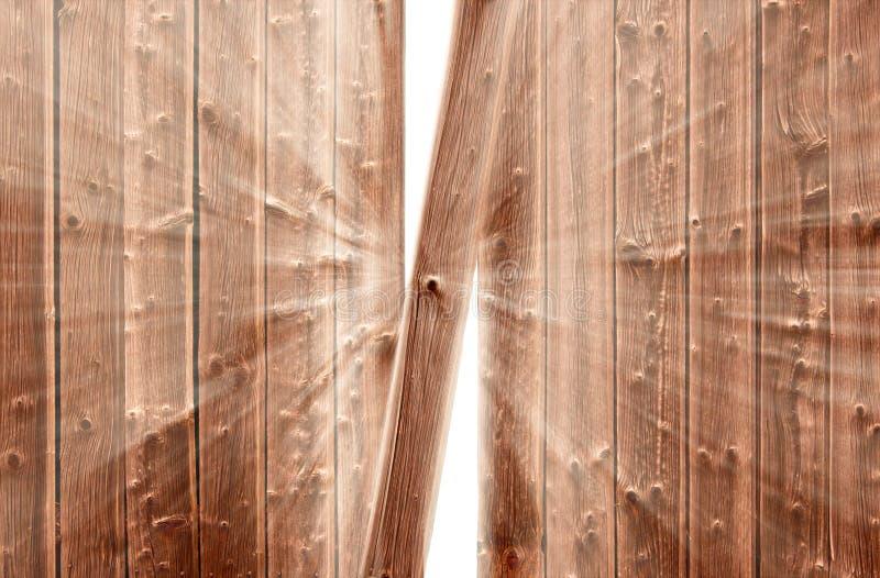 Entaillez dans la frontière de sécurité en bois et la lumière apparaissante image stock