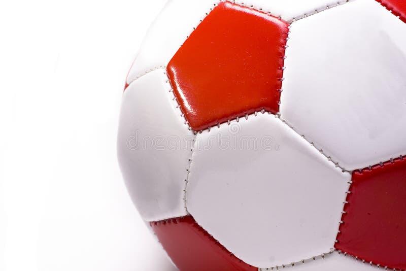 Entalhe vermelho e branco do futebol foto de stock