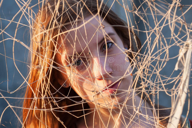 She entangled in the net. Difficulties in choosing a path royalty free stock image