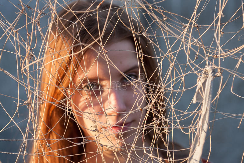 She entangled in the net. Difficulties in choosing a path royalty free stock images