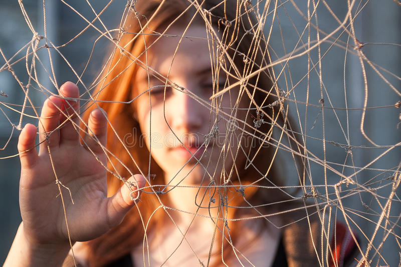 She entangled in the net. Difficulties in choosing a path stock photo