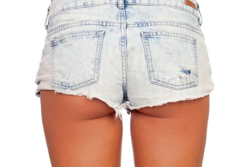 Ente sexy della donna negli shorts del tralicco fotografia stock