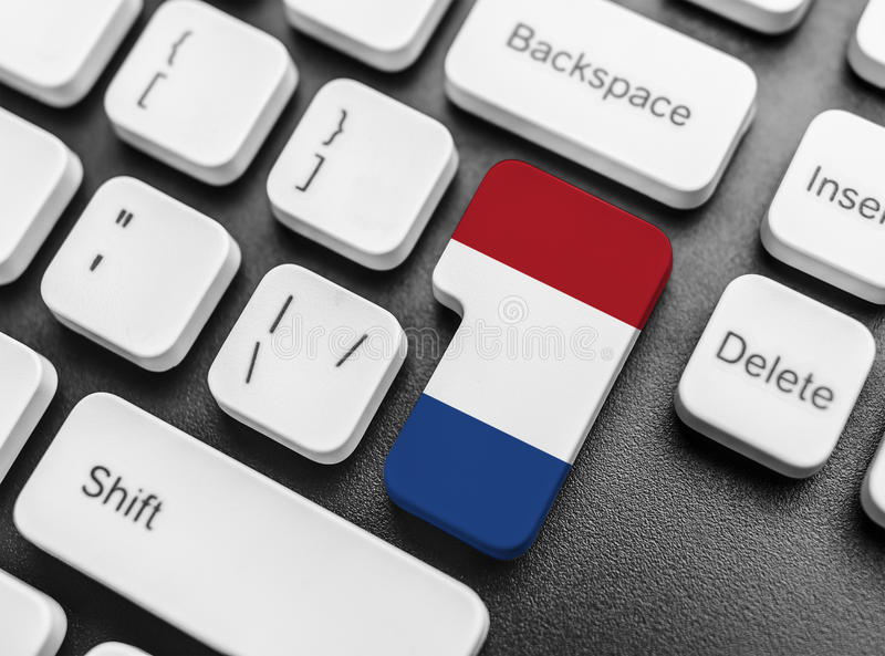 Enter key button with Flag of Netherlands. Close-up stock image