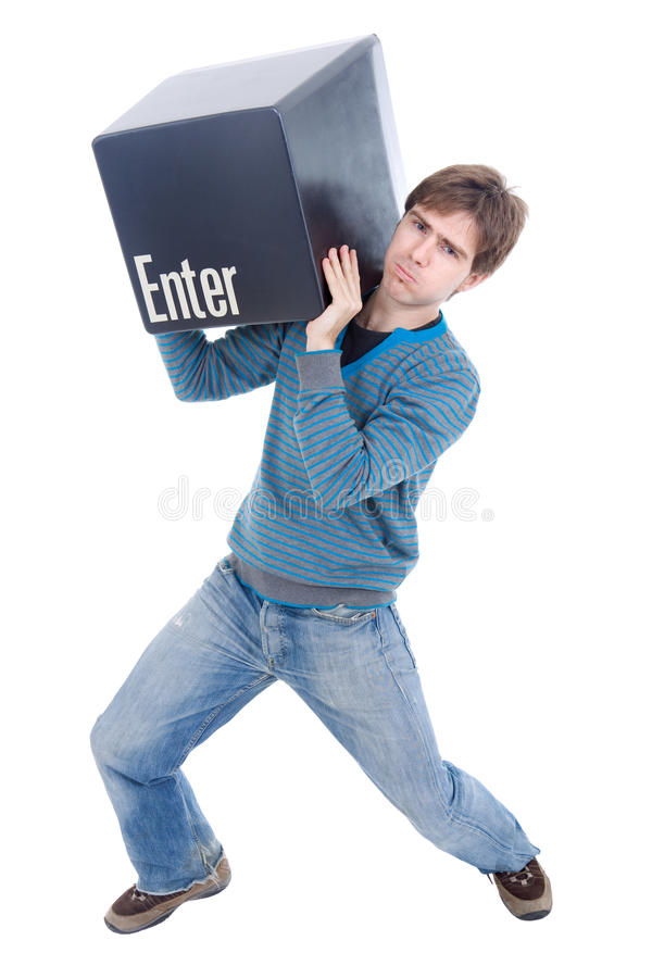 Enter key. Young casual man with the enter key royalty free stock photography
