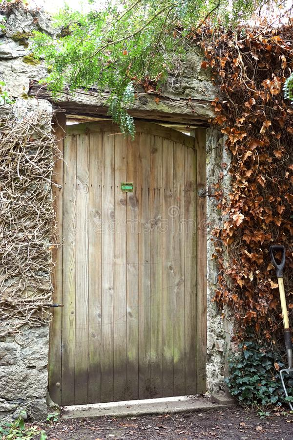Enter by the postern gate. A postern is a secondary door or gate in a fortification such as a city wall or castle curtain wall. Posterns were often found in a royalty free stock photos