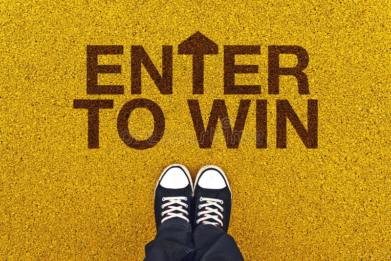 Enter To Win on Asphalt Road royalty free stock photography