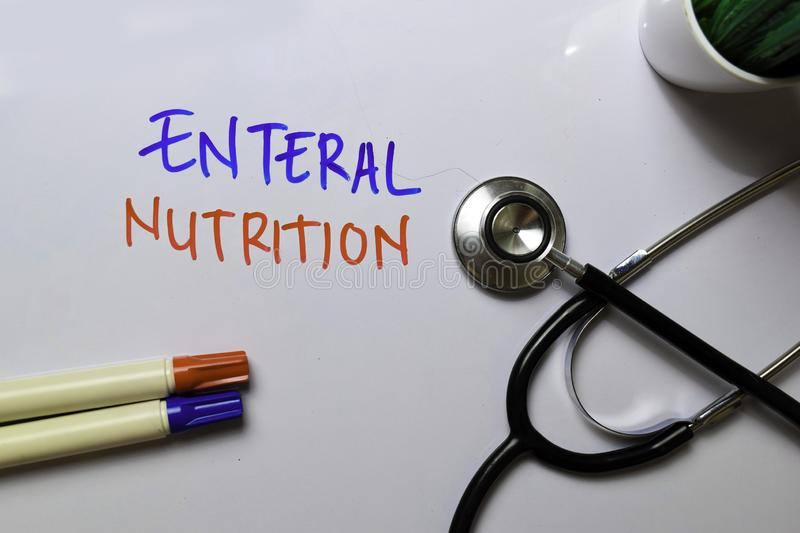 Enteral Nutrition write on white board white stethoscope. Medical or Healthare concept stock photos