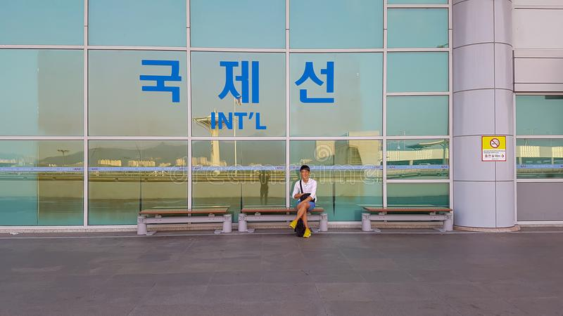 Before entering the airport, under the sign of International Flights royalty free stock photography
