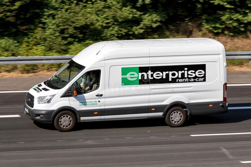 Ford Transit of Enterprise on motorway. Enterprise Rent-A-Car is an American car rental company headquartered in Clayton, Missouri, United States royalty free stock image