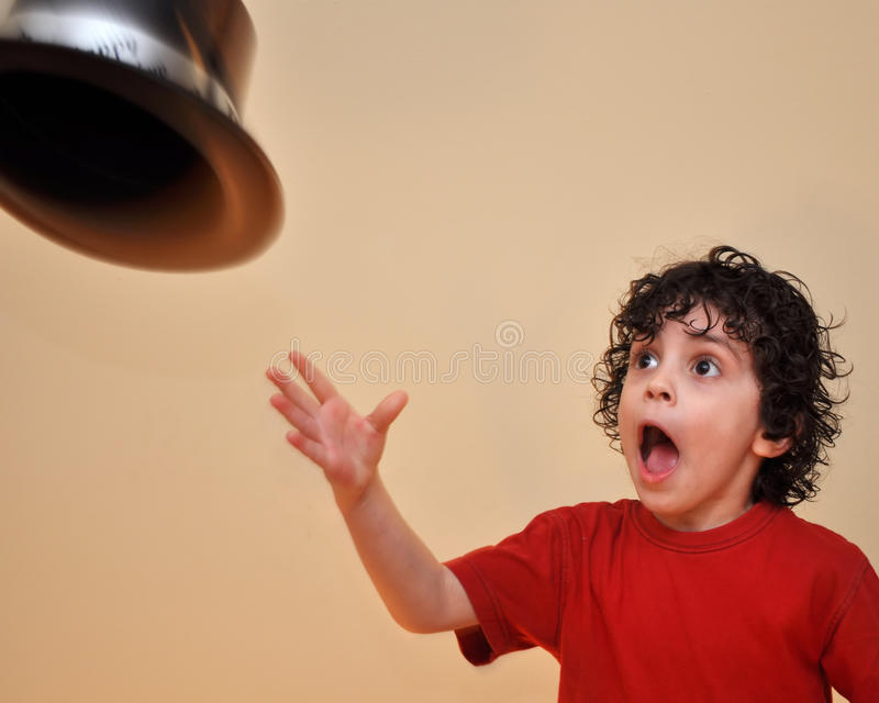 Latino Boy Throwing a Hat Away stock image