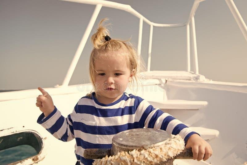 Entertainment jobs. Baby boy enjoy vacation sea cruise ship. Child sailor. Boy sailor travelling sea. Boy sailor striped royalty free stock photos