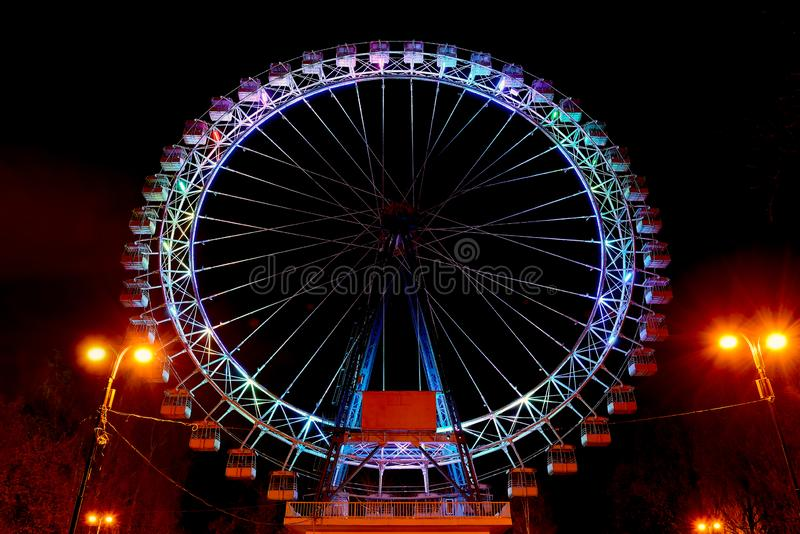 Entertainment in the park. Ferris wheel at night stock images