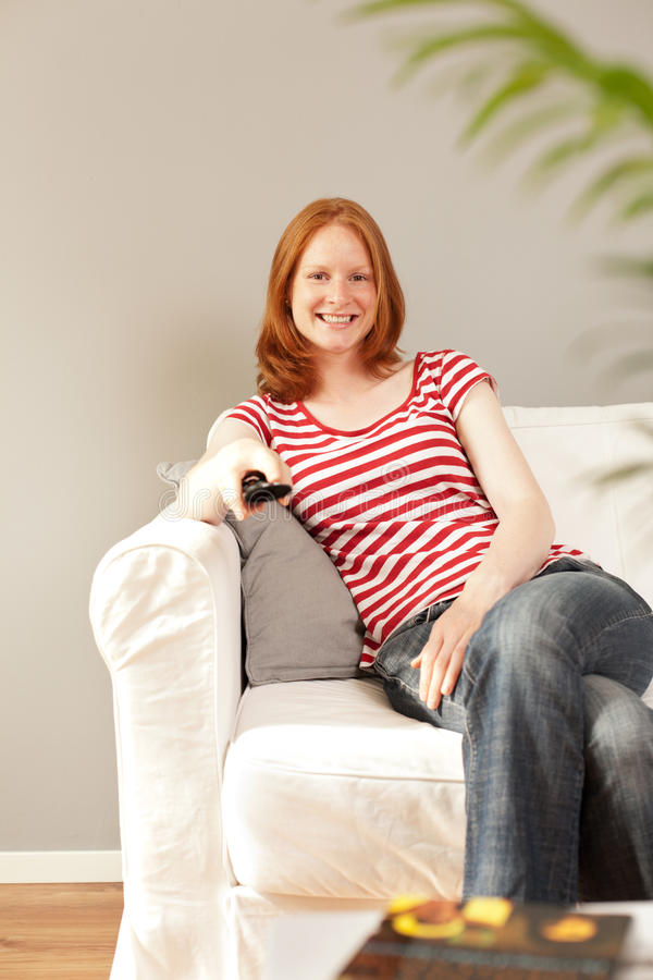 Download Entertainment - A Woman Watching TV Stock Image - Image: 25582823