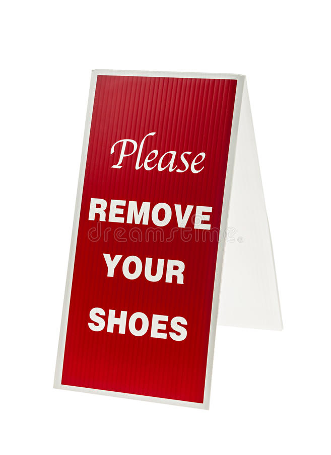 Entfernen Sie Ihr Schuhzeichen lizenzfreies stockfoto