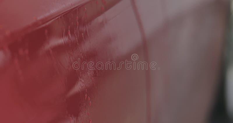 Entfettungsfarbe der roten Waschanlage des Nahaufnahmefokus tränken lizenzfreie stockbilder