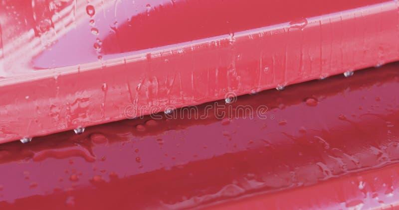 Entfettungsfarbe der roten Waschanlage des Nahaufnahmefokus tränken lizenzfreies stockbild