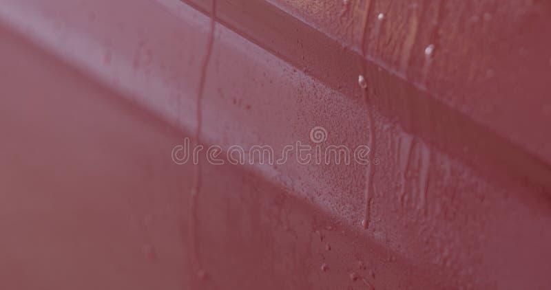 Entfettungsfarbe der roten Waschanlage des Nahaufnahmefokus tränken lizenzfreie stockfotografie
