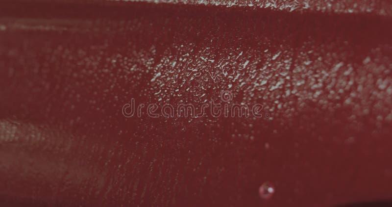 Entfettungsfarbe der roten Waschanlage des Nahaufnahmefokus tränken stockbilder