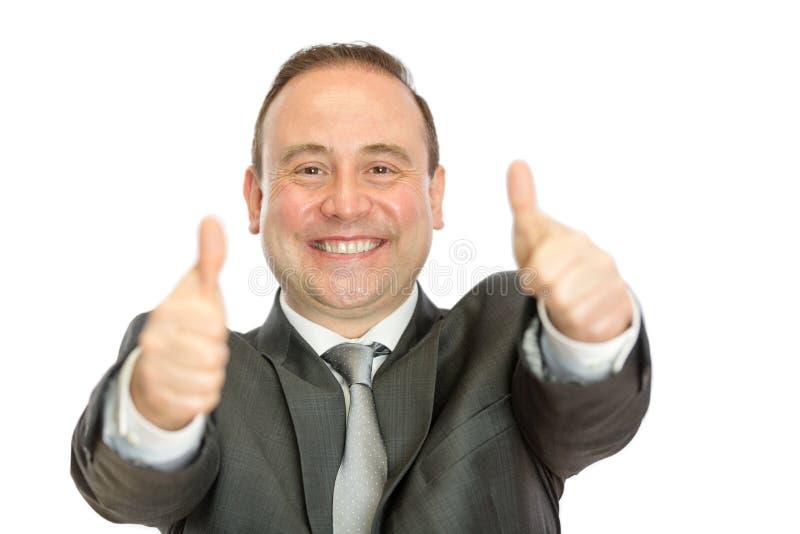 Enthousiaste zakenman die duimen op signaal geven stock afbeelding
