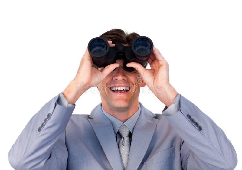 Enthusiastic Businessman Holding Binoculars Stock Photo