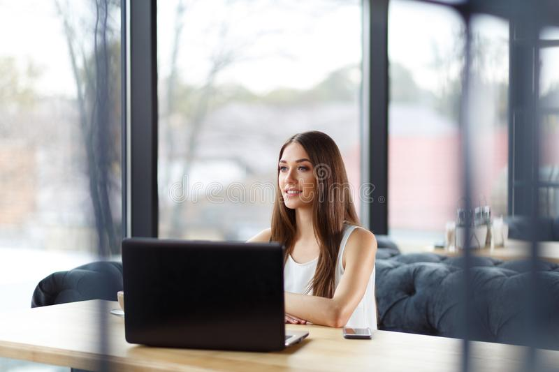 An enthusiastic girl in the office stock images