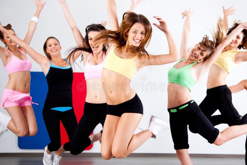 Enthusiastic group of women having fun. During aerobics class stock image