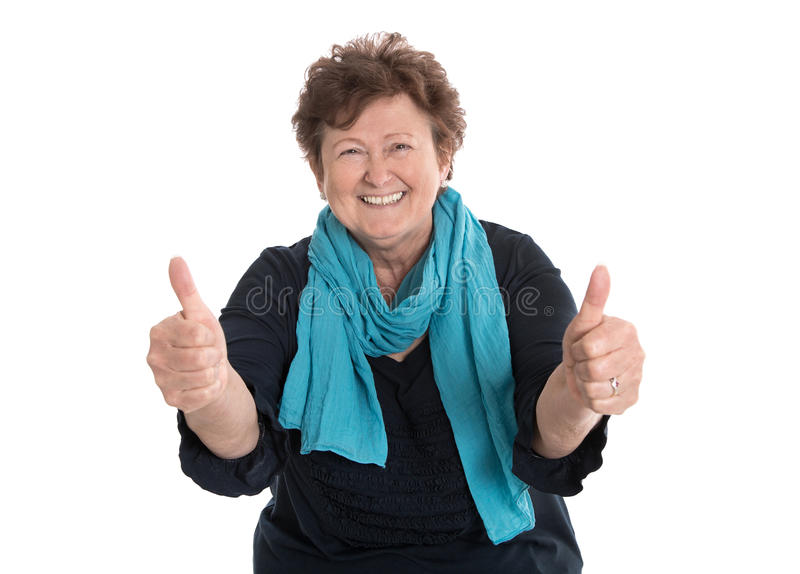 Enthusiastic and happy grandmother making thumbs up gesture with stock photo