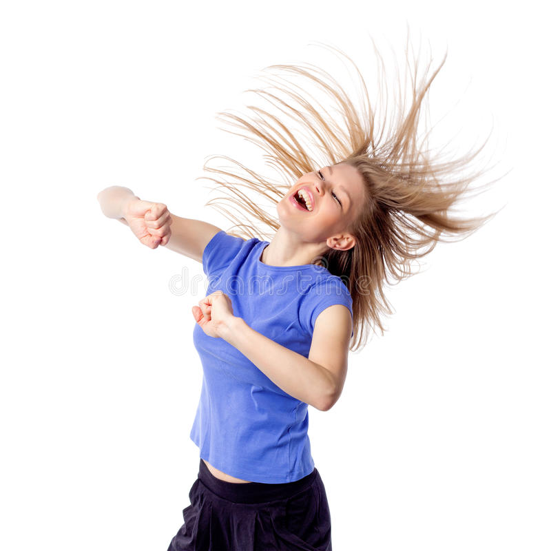 Enthusiastic happy smiling woman dancing royalty free stock image