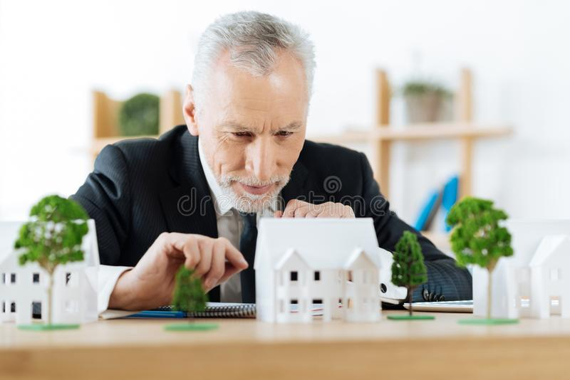 Enthusiastic real estate agent planning the next step in selling a house. Very attentive. Clever experienced reliable real estate agent sitting in his office and stock images