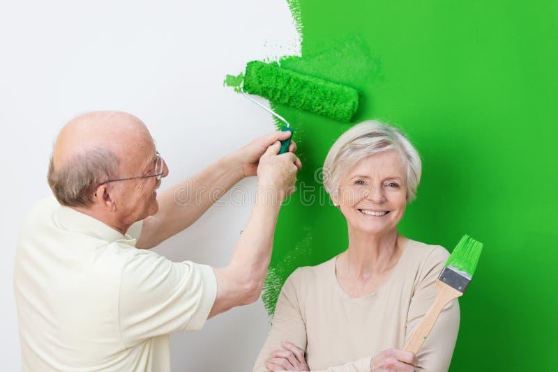 Enthusiastic senior couple renovating stock photos
