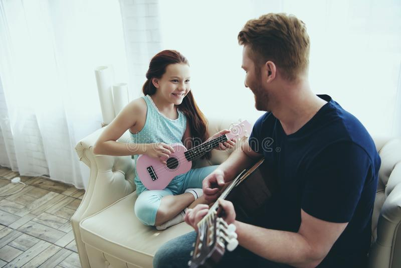 Enthusiastic single father and daughter plays stock photo