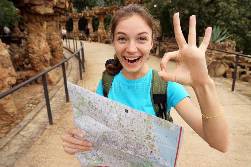 Enthusiastic tourist shows okay gesture. stock photography