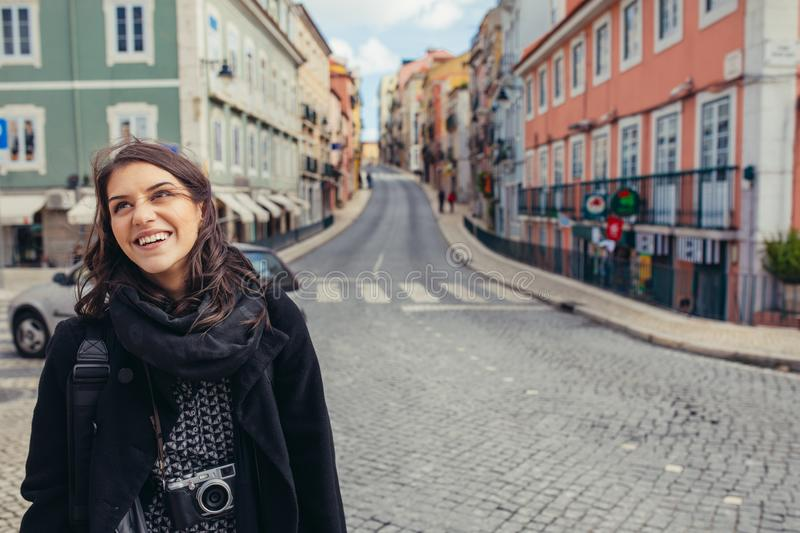 Enthusiastic traveler woman walking streets of european capital.Tourist in Lisbon,Portugal royalty free stock images