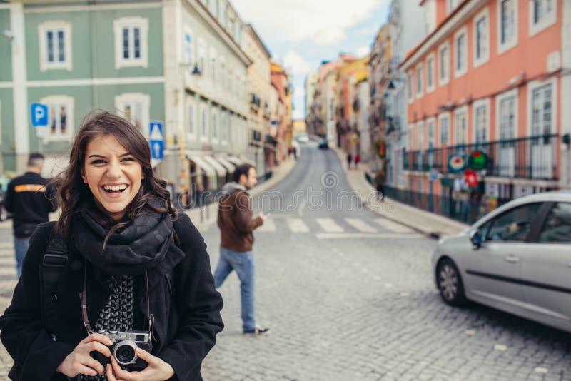 Enthusiastic traveler woman walking streets of european capital.Tourist in Lisbon,Portugal royalty free stock photos