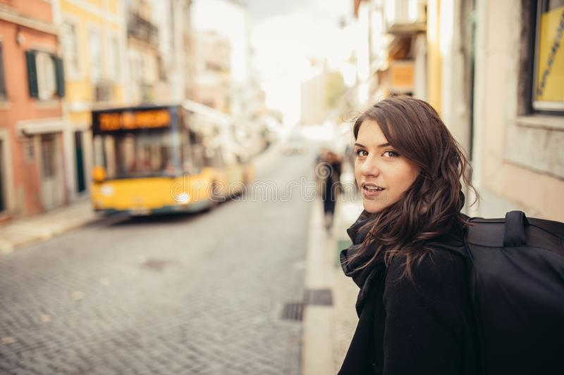 Enthusiastic traveler woman walking streets of european capital.Tourist in Lisbon,Portugal royalty free stock image