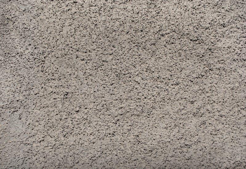 Entlastungsvolumengips auf der Wand des Geb?udes, hellgrau stockbilder