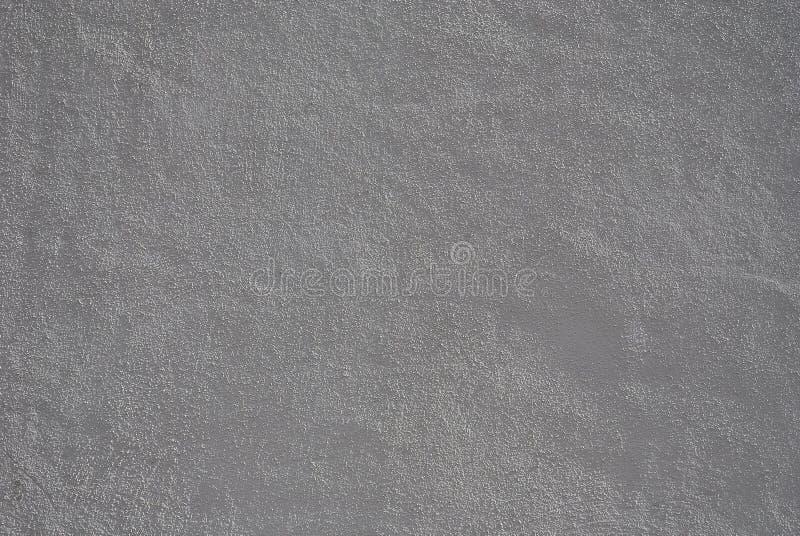 Entlastungsvolumengips auf der Wand des Geb?udes, hellgrau stockfotos
