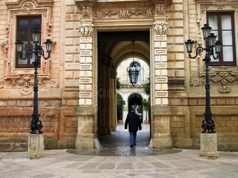 Entrace. A man in a ancient palace entrance - in a italian village royalty free stock photo