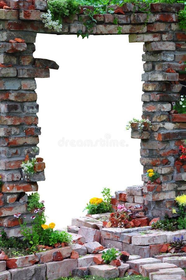 Entrada arqueada através da parede imagem de stock royalty free