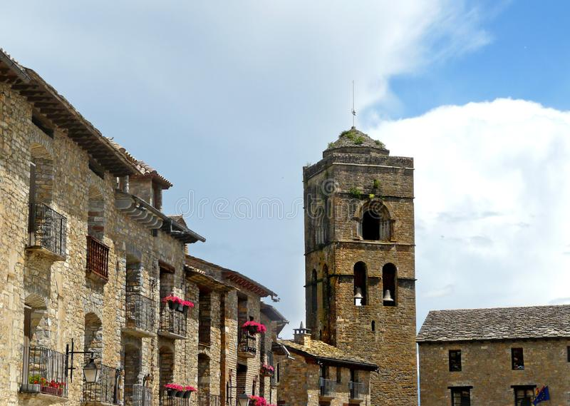 Entral square and medieval church of Ainsa Huesca stock images