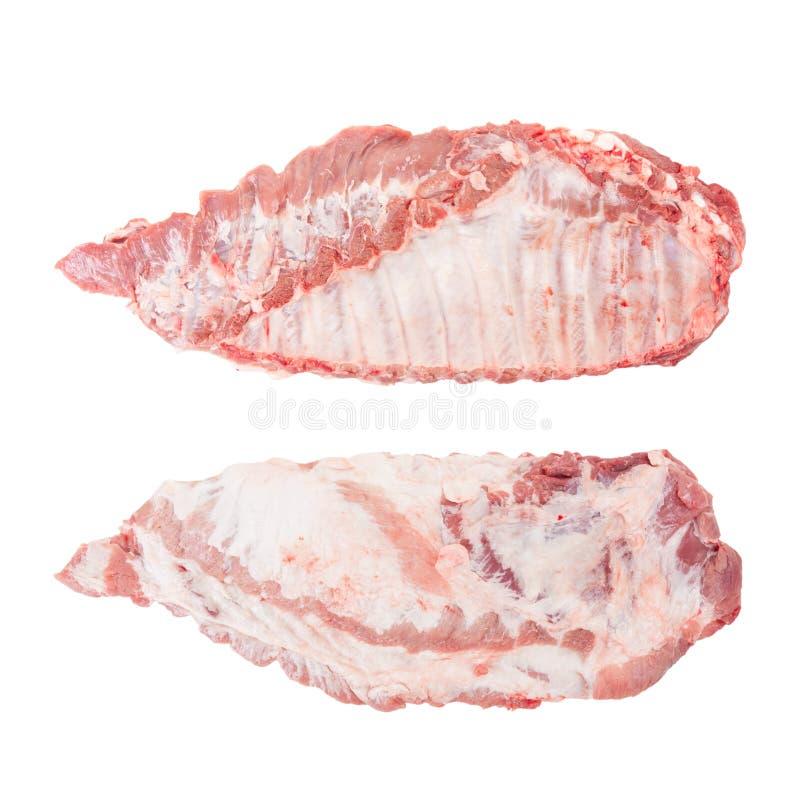 Entrambi i lati delle costole di carne di maiale crude immagine stock