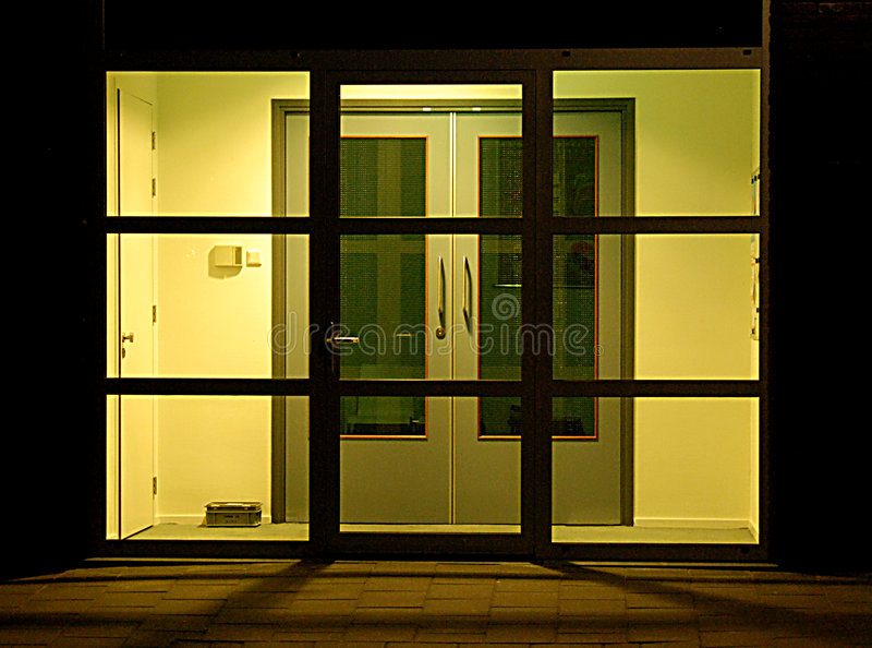 Entrance. The entrance of this officie building is closed, because it is night stock photos