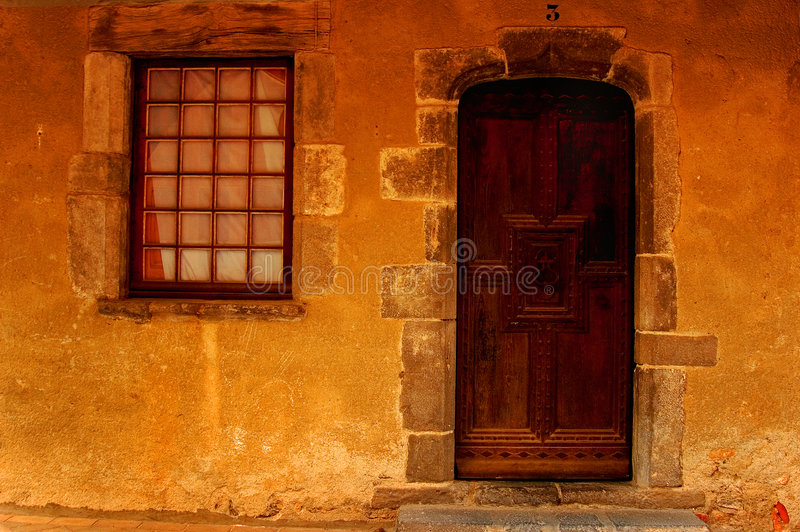 The entrance. Door and wndow of a provencal house (south of france royalty free stock photo