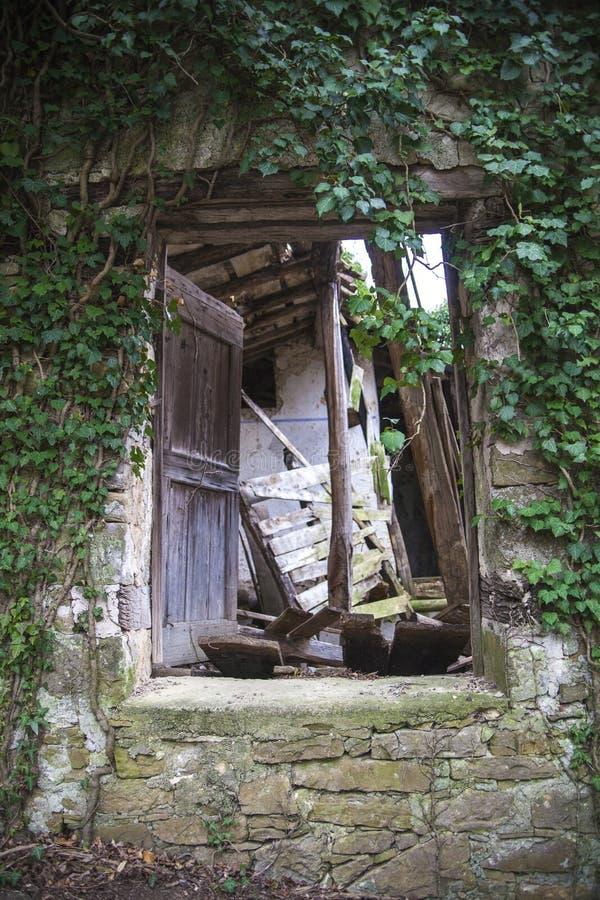 Entrance of abandoned house stock image