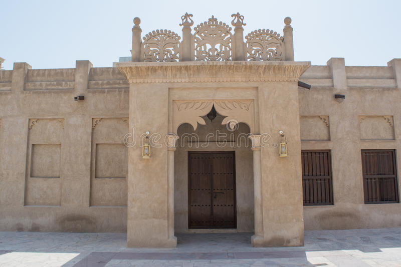 Entrance in the amazing beautiful ancient historical creamy brown building. In the UAE royalty free stock photo